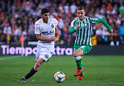 February 28, 2019 - Valencia, U.S. - VALENCIA, SPAIN - FEBRUARY 28: Giovani Lo Celso, midfielder of Real Betis Balompie competes for the ball with Gonalo Guedes, midfielder of Valencia CF during the Copa del Rey match between Valencia CF and Real Betis Balompie at Mestalla stadium on February 28, 2019 in Valencia, Spain. (Photo by Carlos Sanchez Martinez/Icon Sportswire) (Credit Image: © Carlos Sanchez Martinez/Icon SMI via ZUMA Press)