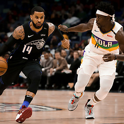 Feb 12, 2019; New Orleans, LA, USA; Orlando Magic guard D.J. Augustin (14) drives past New Orleans Pelicans guard Jrue Holiday (11) during the first quarter at the Smoothie King Center. Mandatory Credit: Derick E. Hingle-USA TODAY Sports