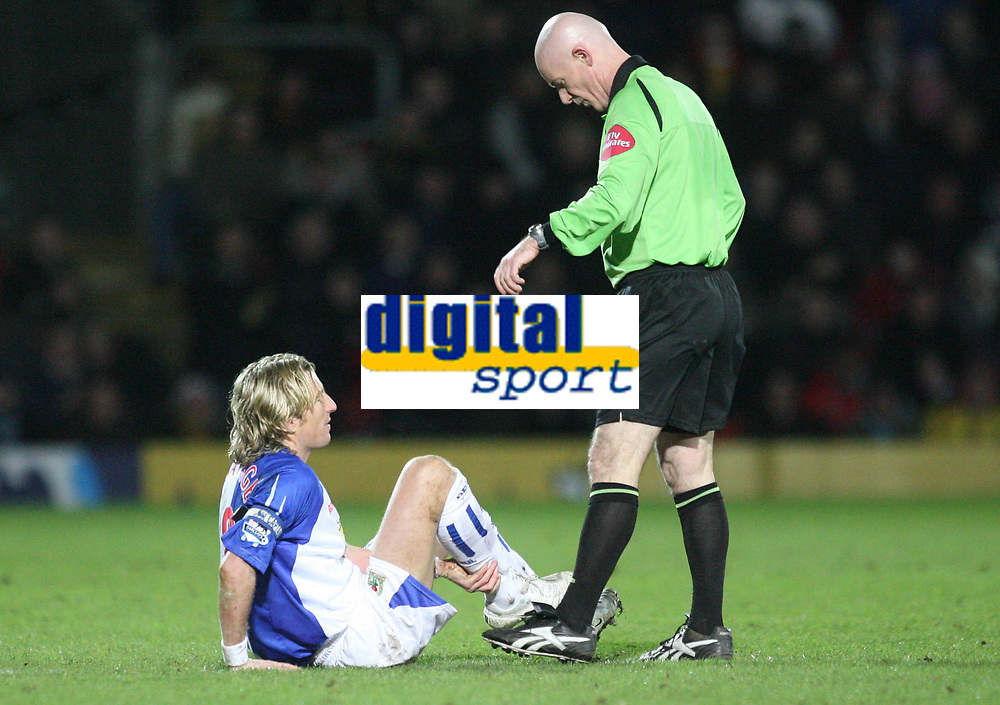 Photo: Marc Atkins.<br /> Watford v Blackburn Rovers. The Barclays Premiership. 23/01/2007. Robbie Savage, (L) speaks with Referee Dermot Gallagher as he lays injured after a challenge with Al Bangura (unseen) of Watford. It is later discovered that Savage has suffered a broken leg in the challenge.