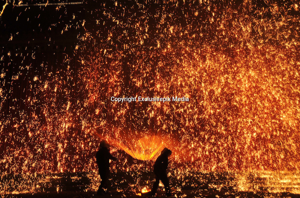 ANYANG, CHINA - JANUARY 31: <br /> <br /> Artists perform Stunning iron fireworks <br /> <br /> Folk artists perform molten iron fireworks at a scenic area in Neihuang County to celebrate the Lunar New Year on January 31, 2017 in Anyang, Henan Province of China. Folk artists use planks hit the molten iron up to the sky to make fireworks in the celebrations. <br /> &copy;Exclusivepix Media