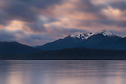 Long exposure of a cloudy sunset at Lake Te Anau, Fiordland, New Zealand.