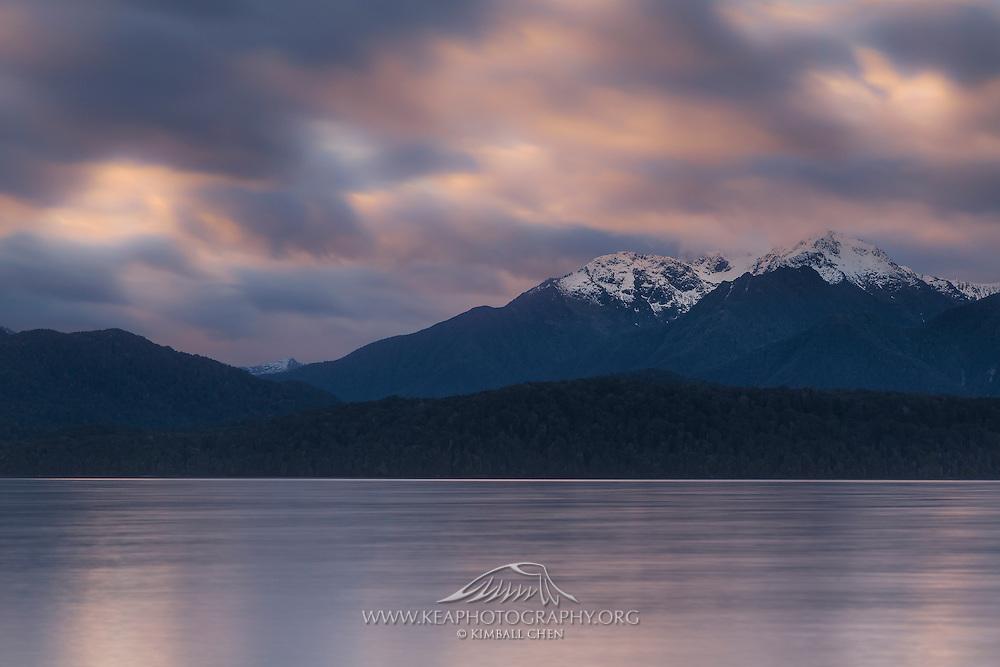 Long exposure of a cloudy sunset at Lake Te Anau, Fiordland, New Zealand.