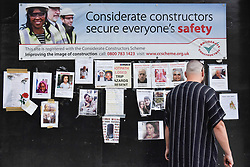 © Licensed to London News Pictures. 23/06/2017. London, UK. A nearby construction site has a wall adorned with missing persons signs.  Nine days on, police have reported that the Grenfell Tower fire in west London started in a fridge-freezer, and outside cladding and insulation failed safety tests. Photo credit : Stephen Chung/LNP