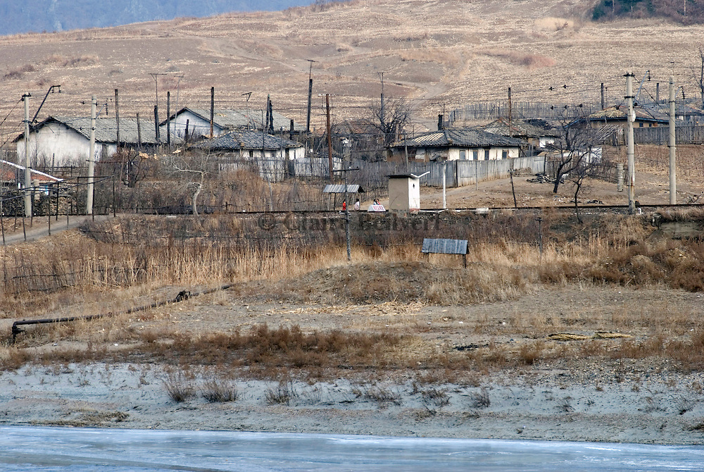 North Korean village near Hoeryong on the border with China, along the frozen Tumen river. Soldiers watching the border have the right to shoot whoever tries to cross the Tumen river to escape to China.