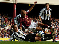 Photo: Henry Browne.<br /> Arsenal v Newcastle Utd. Barclaycard Premiership.<br /> 14/08/2005.<br /> Scott Parker of Newcastle foils an attempt by Arsenal's Fredrik Ljungberg.
