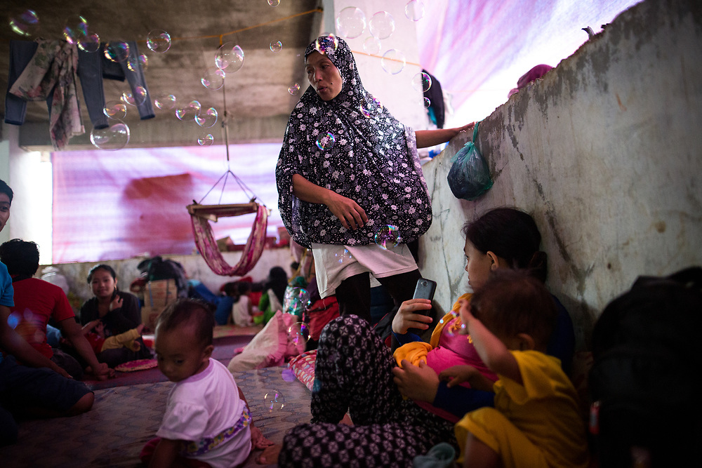"MARAWI, PHILIPPINES - JUNE 10: Displaced residents try to live in a difficult conditions at an temporary evacuation center in Municipality of Saguiaran, Marawi, Southern Philippines, June 10, 2017. It's unclear how many people remain trapped in Marawi as government troops continue to battle Islamists rebels led by the so-called ""Maute"" group but army officers have put the figure this week at anywhere from 150 to 1,000.  (Photo: Richard Atrero de Guzman/NUR Photo)"