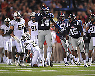 Ole Miss linebacker Serderius Bryant (14) tackles Vanderbilt running back Brian Kimbrow (25) at Vaught-Hemingway Stadium in Oxford, Miss. on Saturday, November 10, 2012. (AP Photo/Oxford Eagle, Bruce Newman)