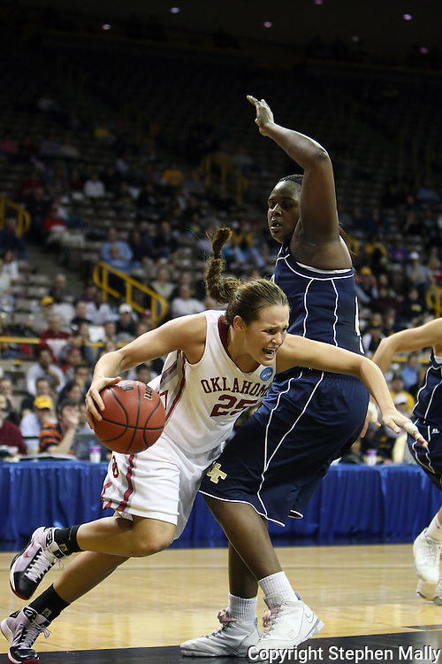 24 MARCH 2009: Oklahoma guard Whitney Hand (25) tries to drive around Georgia Tech center Sasha Goodlett (45) during an NCAA Women's Tournament basketball game Tuesday, March 24, 2009, at Carver-Hawkeye Arena in Iowa City, Iowa. Oklahoma defeated Georgia Tech 69-50.