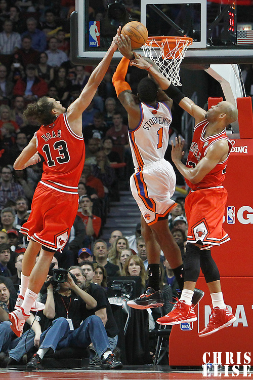 12 March 2012: New York Knicks power forward Amare Stoudemire (1) draws a foul on Chicago Bulls forward Taj Gibson (22) during the Chicago Bulls 104-99 victory over the New York Knicks at the United Center, Chicago, Illinois, USA.