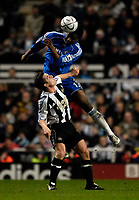 Photo: Jed Wee.<br /> Newcastle United v Chelsea. Carling Cup. 20/12/2006.<br /> <br /> Chelsea's John Obi Mikel (R) jumps above Newcastle's Scott Parker to win the ball.