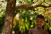 A girl stands under a tree in the village of Mabanta on Friday February 27, 2009.