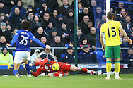 Picture by Paul Chesterton/Focus Images Ltd.  07904 640267.17/12/11.John Ruddy of Norwich saves at the feet of Marouane Fellaini of Everton during the Barclays Premier League match at Goodison Park Stadium, Liverpool.