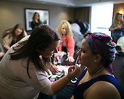 Rachel Nasca applies makeup for Angeline De Jesus of Rochester at a Prom for patients at Strong Hospital at the Strathallan in Rochester on Saturday, April 11, 2015.