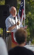 Michigan Congressional Representative and potential gubernatorial candidate Pete Hoekstra speaks at a Tax and Spend Must End sponsored rally in Petoskey, Michigan's Pennsylvania Park.