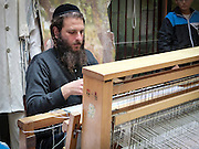 Weaving a talith on a loom Photographed in Jerusalem, Israel,