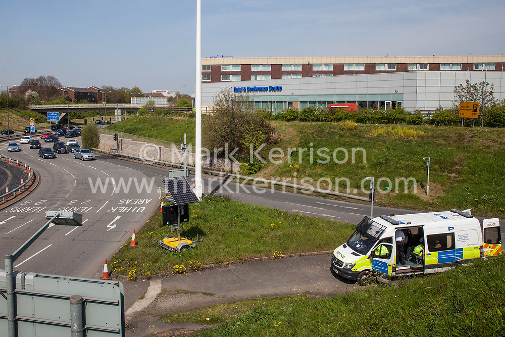 London, UK. 19th April, 2019. Police officers keep watch from a vehicle parked alongside the main motorway approach to Heathrow airport following a small protest earlier by Extinction Rebellion Youth. A large policing operation was put in place in and around the airport in preparation for expected protests by climate change activists from Extinction Rebellion. Only a very small symbolic protest by teenage activists from Extinction Rebellion Youth took place, dispersed by police officers under threat of arrest.