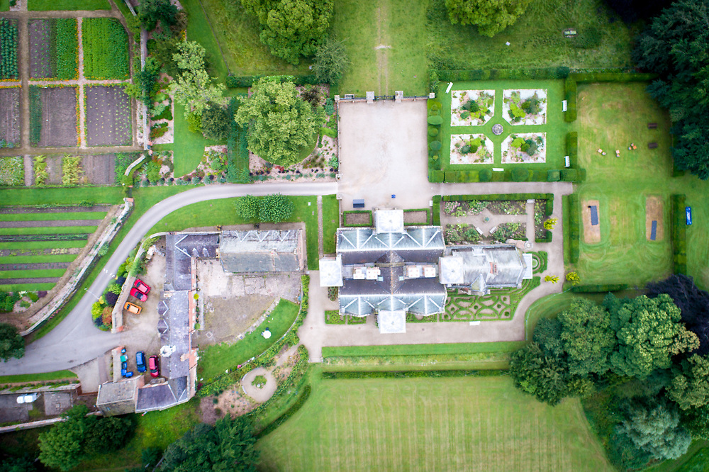Overview of historic Kiplin Hall and its well kept grounds, North Yorkshire, England