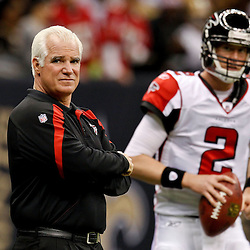 December 26, 2011; New Orleans, LA, USA; Atlanta Falcons head coach Mike Smith stands with quarterback Matt Ryan (2) during a game against the Atlanta Falcons at the Mercedes-Benz Superdome. The Saints defeated the Falcons 45-16.  Mandatory Credit: Derick E. Hingle-US PRESSWIRE
