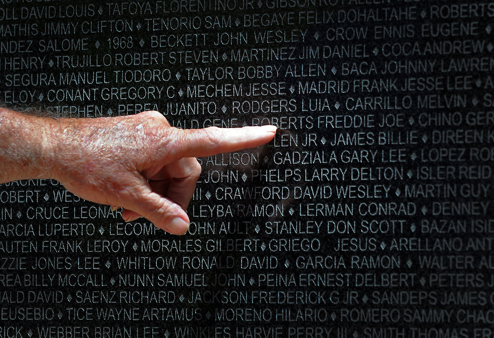 jt052917o/ a sec/jim thompson/Vietnam Veteran John Dunlap points out names of fallen friends to his wife Holly at the Vietnam Memorial at the New Mexico Veteran's Memorial. Monday May. 29, 2017. (Jim Thompson/Albuquerque Journal)
