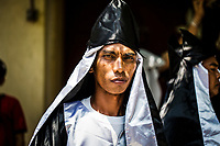 A portrait of a young man during the Holy Week processions in Pampagna, the Philippines.