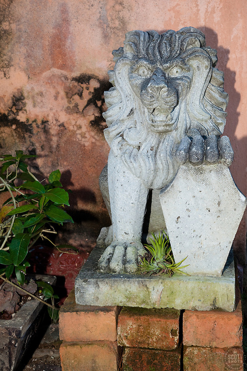 """""""Lion on Bricks"""" - This stone lion on a pile of bricks was photographed in Puerto Vallarta, Mexico."""