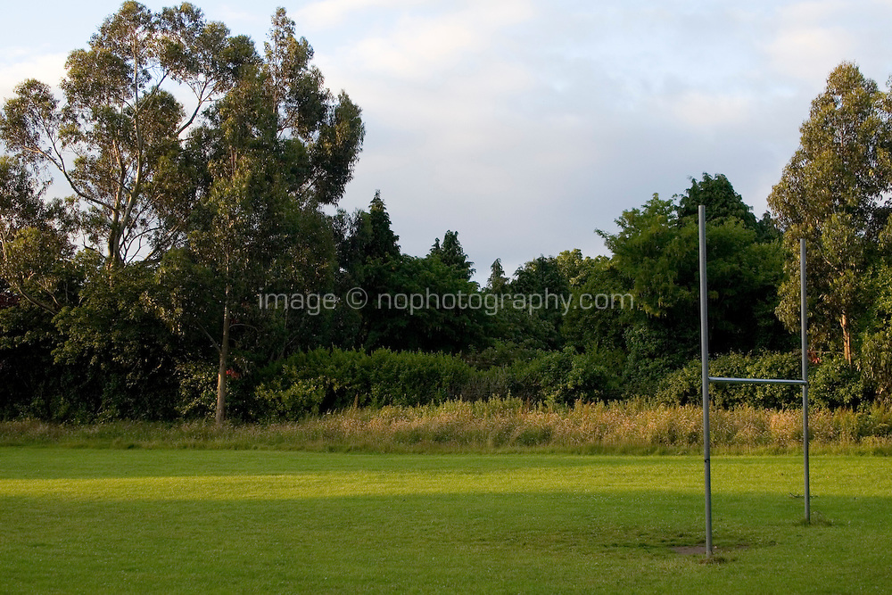 Football field in suburban Dublin, Ireland in evening summer sunlight