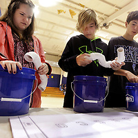 "Adam Robison | BUY AT PHOTOS.DJOURNAL.COM<br /> Sarah Dulaney, Carson Mayhall and Will Gentry, seventh graders at Guntown Middle School, put plumbing parts together at the ""JESCO Puzzle"" interactive table where each bucket of parts forms a letter to spell JESCO and teach how plumbing parts got together Friday morning in Guntown."