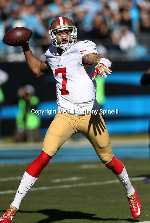 San Francisco 49ers quarterback Colin Kaepernick (7) throws a pass on a first quarter play during the NFC Divisional Playoff NFL football game against the Carolina Panthers on Sunday, Jan. 12, 2014 in Charlotte, N.C. The 49ers won the game 23-10. ©Paul Anthony Spinelli