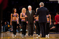 27 October 2009: Tex Winter, Assistant coach of the Los Angeles Lakers and creator of the triangle offense walks in with the Laker Girls and receives his ring from commissioner David Stern during the Lakers 99-92 victory over the Los Angeles Clippers at the STAPLES Center in Los Angeles, CA.
