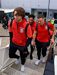 CARDIFF, WALES - Saturday, June 10, 2017: Wales' James Chester boards the team plane as the squad depart Cardiff Tesla Airport to travel to Belgrade ahead of the 2018 FIFA World Cup Qualifying Group D match against Serbia. (Pic by David Rawcliffe/Propaganda)