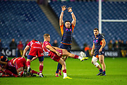 Murray Douglas (#5) of Edinburgh Rugby tries to block the clearing kick of Kieran Hardy (#9) of Scarlets during the Guinness Pro 14 2019_20 match between Edinburgh Rugby and Scarlets at BT Murrayfield Stadium, Edinburgh, Scotland on 26 October 2019.