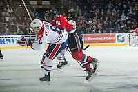 KELOWNA, CANADA - NOVEMBER 7: Nick Merkley #10 of Kelowna Rockets checks Jordan Henderson #8 of Spokane Chiefs on November 7, 2014 at Prospera Place in Kelowna, British Columbia, Canada.  (Photo by Marissa Baecker/Shoot the Breeze)  *** Local Caption *** Nick Merkley; Jordan Henderson;