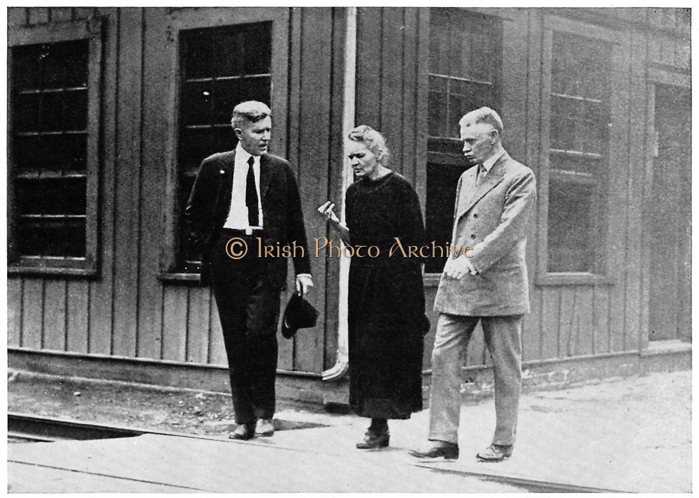 Marie CURIE (1867-1934) Polish-born French physicist and Nobel laureate during her tour of the United States in 1921 in discussion with two fellow scientists at Pittsburgh.