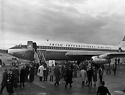 """06/12/1960<br /> 12/06/1960<br /> 06 December 1960<br /> Inaugural flight of new Irish Boeing Jetliner """"Padraig"""" to New York. Image shows the excitement around the plane as passengers prepare to board."""