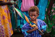 Ni Vanuat girl in a church dress with an umbrella. Uleveo, Maskelyne Island, Malampa Province, Malekula, Vanuatu