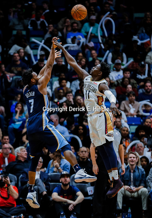 Jan 20, 2018; New Orleans, LA, USA; Memphis Grizzlies guard Wayne Selden (7) shoots over New Orleans Pelicans guard Jrue Holiday (11) during the second half at the Smoothie King Center. The Pelicans defeated the Grizzlies 111-104. Mandatory Credit: Derick E. Hingle-USA TODAY Sports