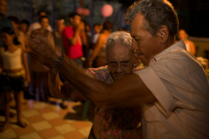 "Jesus Da?vila on the day of her 100 birthday, here dancing with a ""young boy"""