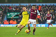 Burton Albion's Tom Naylor and Aston Villa's Jack Grealish during the EFL Sky Bet Championship match between Aston Villa and Burton Albion at Villa Park, Birmingham, England on 3 February 2018. Picture by John Potts.