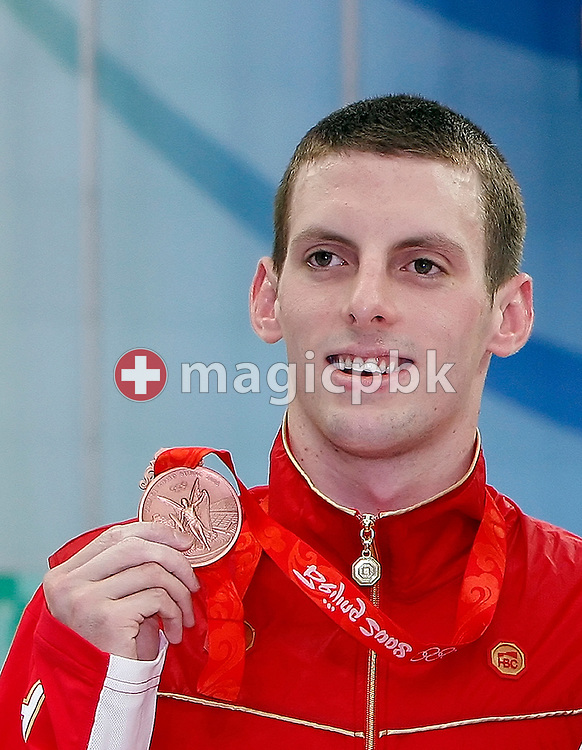 Third placed Ryan COCHRANE of Canada poses with his bronze medal after competing in the Men's 1500m Freestyle Final held at the National Aquatics Center (Water Cube) at the Beijing 2008 Olympic Games in Beijing, China, Sunday, Aug. 17, 2008. (Photo by Patrick B. Kraemer / MAGICPBK)