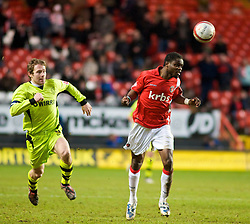 LONDON, ENGLAND - Saturday, January 30, 2010: Charlton Athletic's Sam Sodje is closed down by Tranmere Rovers' Ian Moore during the Football League One match at the Valley. (Photo by Gareth Davies/Propaganda)