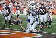 Indianapolis Colts running back Trent Richardson (34) looks on as Indianapolis Colts quarterback Andrew Luck (12) gets upended in the end zone as scores on an 11 yard touchdown run that ties the second quarter score at 7-7 during the NFL week 14 regular season football game against the Cleveland Browns on Sunday, Dec. 7, 2014 in Cleveland. The Colts won the game 25-24. ©Paul Anthony Spinelli