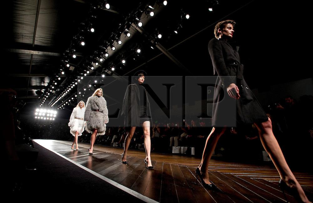 © London News Pictures. 15/02/2013. London, UK. A model walks the runway at the Felder Felder show by designers Annette Felder and Daniela Felder  at London Fashion Week Autumn Winter 2013/14 on February 15, 2013. Photo credit : Ben Cawthra/LNP