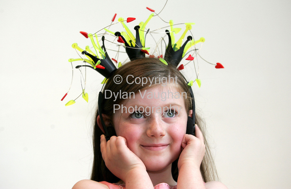 "8/8/2004.Catriona Irvine aged seven from Carlingford pictured trying on a piece jewellery entitled ""Dancing Queen"" by Lillan Eriksson at the opening of an exhibition of Norwegian Contemorary Jewellery at the Crafts Council of Irelands National Craft Gallery in Kilkenny as part of the Kilkenny Arts Festival..Picture Dylan Vaughan"