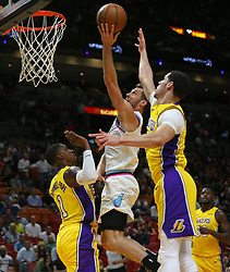 March 1, 2018 - Miami, FL, USA - The Miami Heat's Goran Dragic, middle, goes to the basket against the Los Angeles Lakers' Kentavious Caldwell-Pope (1) and Lonzo Ball during the first quarter at the AmericanAirlines Arena in Miami on Thursday, March 1, 2018. The Lakers won, 131-113. (Credit Image: © David Santiago/TNS via ZUMA Wire)