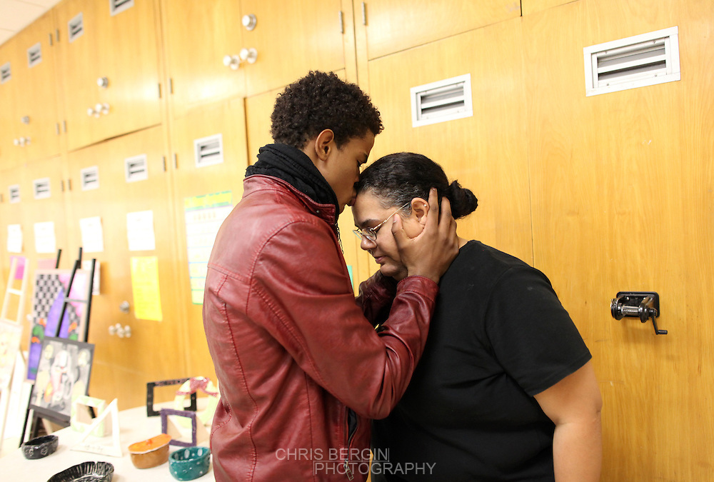 Actor and musician Trevor Jackson kisses his mother Cam Baxter on the head before performing a song during a Christmas program at Manuel High School Tuesday December 18, 2012. Jackson attended the Concord Community Center as a younger child and was back visiting his home town. .Chris Bergin/ for The Star