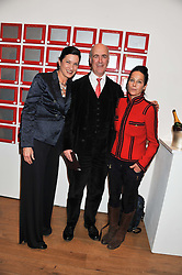 Left to right, MARGARETH HENRIQUEZ President & CEO of Krug, CHARLES SAUMAREZ SMITH and LADY AMANDA HARLECH at the launch of the Krug Happiness Exhibition at The Royal Academy, 6 Burlington Gardens, London on 12th December 2011.