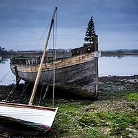 old abandoned boat hulk on shore