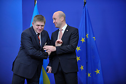 Robert Fico, Slovakia's president, left, arrives for the European Union Summit and is greeted by Fredrik Reinfeldt, Sweden's prime minister and standing president of the European Council, at the EU headquarters in Brussels, Belgium, on Thursday, Nov. 19, 2009. European leaders will try to set divisions aside today as they choose their first-ever European Union president to represent the 27-nation bloc on the world stage. (Photo © Jock Fistick).