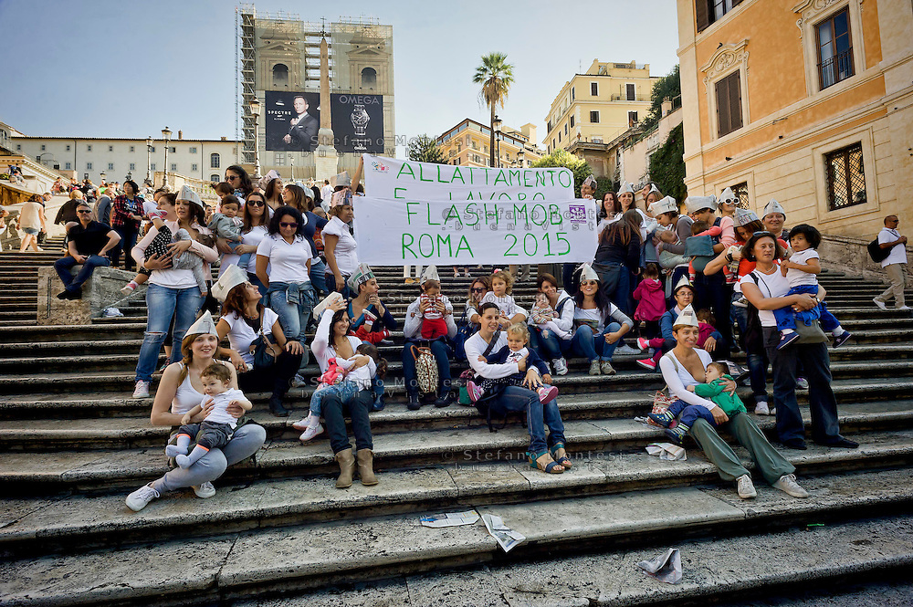 ROME, ITALY - OCTOBER 3: Mothers gather on the the Trinita dei Monti, during the World Week for the breastfeeding, organized  by the Movement Lactation Maternal Italian with the aim of promoting the benefits of breastfeeding on October 3, 2015 in Rome, Italy.