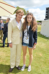 LORD SETTRINGTON and LILY ATKINSON at the Cartier hosted Style et Lux at The Goodwood Festival of Speed at Goodwood House, West Sussex on 29th June 2014.